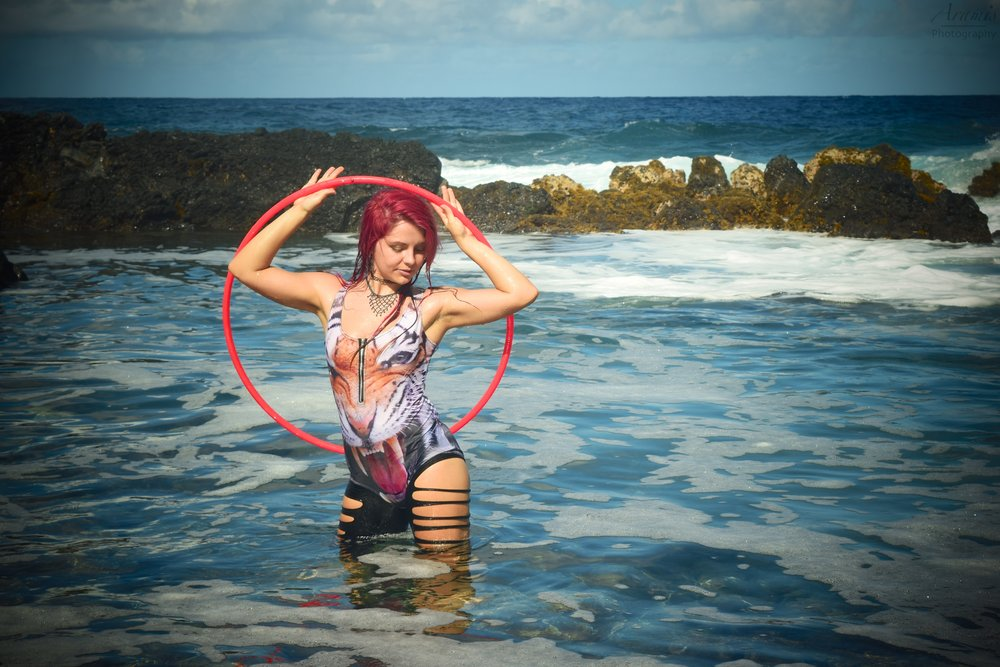 Lisa SparkGirl Hiptronic Arts head hoopanista who has been crafting up handmade hula hoops since 2010! Her hooping journey originally began in her homestate of Ohio, and now she currently resides on the Big Island of Hawai'i offering both hoop dance instruction and performance.