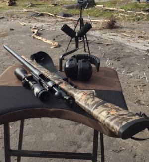 Savage 212 Bolt Action Fully Rifled Shotgun with Nikon Slughunter scope.