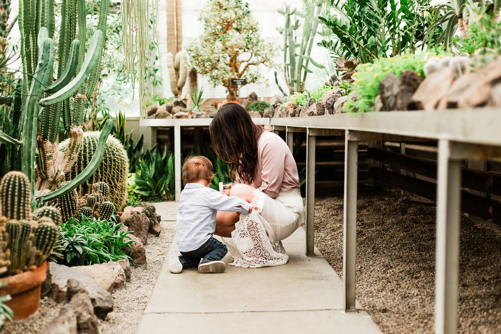 mom and baby in greenhouse photoshoot