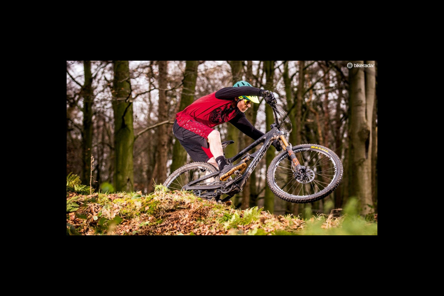 """ What we do know is that the Zerode is truly outstanding with gravity rather than gears providing the speed. With a 65-degree head angle and 445mm reach on a size large it's slack but short-ish. The UK build includes a Burgtec 800mm carbon bar, a 50mm stem and an optional £400 upgrade Fox 36 RC2 fork that feel spot-on through the wired and glued motocross style mushroom grips. What happens when you tip all that into a corner is remarkable though as the low centred gearbox weight literally adds several degrees of lean once you've got the confidence to grab them. The gear-free rear end is outrageously sensitive too. I've never had a Fox Factory Float X shock feel better and it delivers the kind of seamless ground tracking and hyper rich HD traction feel you normally only get through a pro-tuned coil shock."" Read the full review at the link below. Bike Radar Taniwha review"
