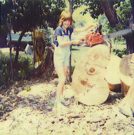 My dad loved to pose me with a saw and a freshly cut tree.