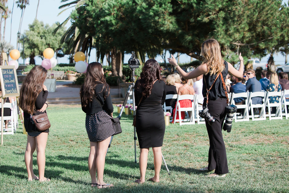 Here's a behind the scenes shot of me having a pow wow with the videography team before the ceremony. I was probably telling them I'm going to get a wide shot of the bride walking down the aisle (aka please don't get in my shot).