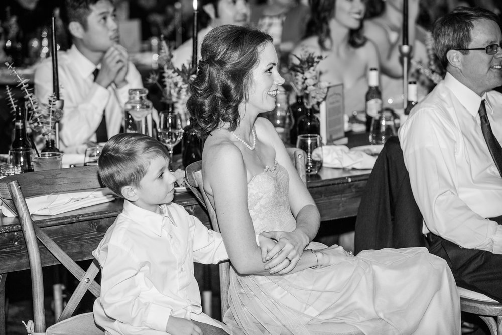 This is a shot of the groom's sister and nephew listening to speeches. This little boy was so sweet and kept reaching for his mom's hand, it seems, just to be connected with her. I think this is one of those shots that will be cherished in 20 years when he's a grown man.