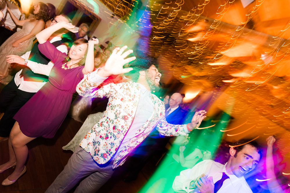 There's always that one guy that gets REALLY into it on the dance floor. He was that guy. This image really captures the energy and movement from the dance floor. I love to use my light dragging technique to create more movement and liveliness in dance floor shots.