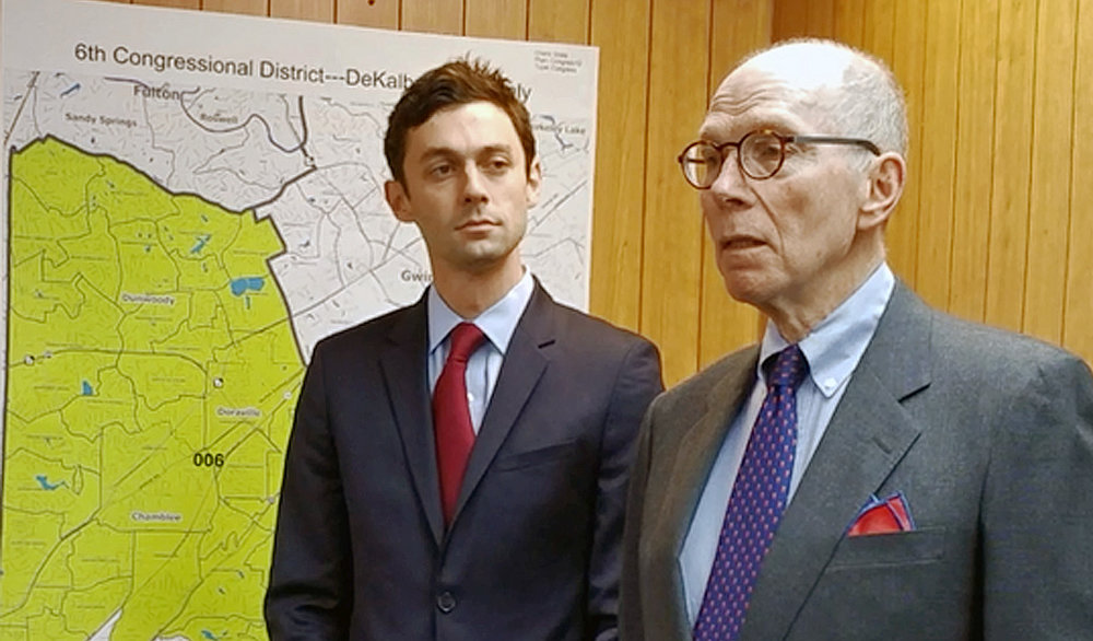 Photo: Ossoff is joined by former CDC director Dr. Jeffrey Koplan at a news conference in Chamblee on Monday morning.
