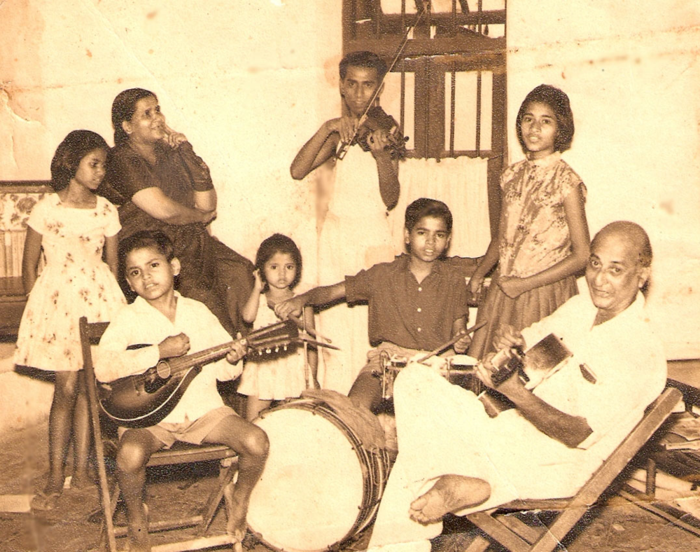 Young Ivan Arthur on the violin. His father is playing the guitar while his brothers play various other instruments and the women join in the singing. Courtesy Ivan Arthur.