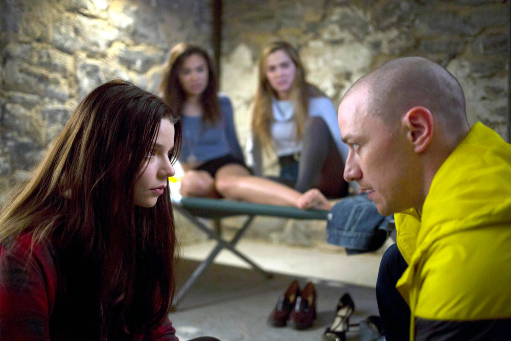 The three kidnapped teenagers confront one of their captor's personalities in their underground cell.