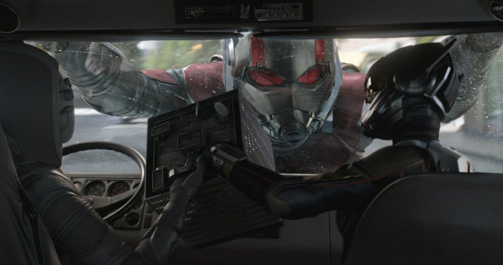 Ghost, Wasp, and Ant-Man fight over technology in and around a car.