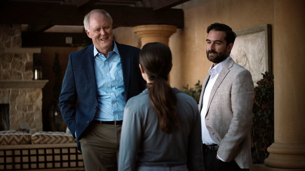 Beatriz (Salma Hayek) meets Doug (John Lithgow) for the first time at the dinner party.