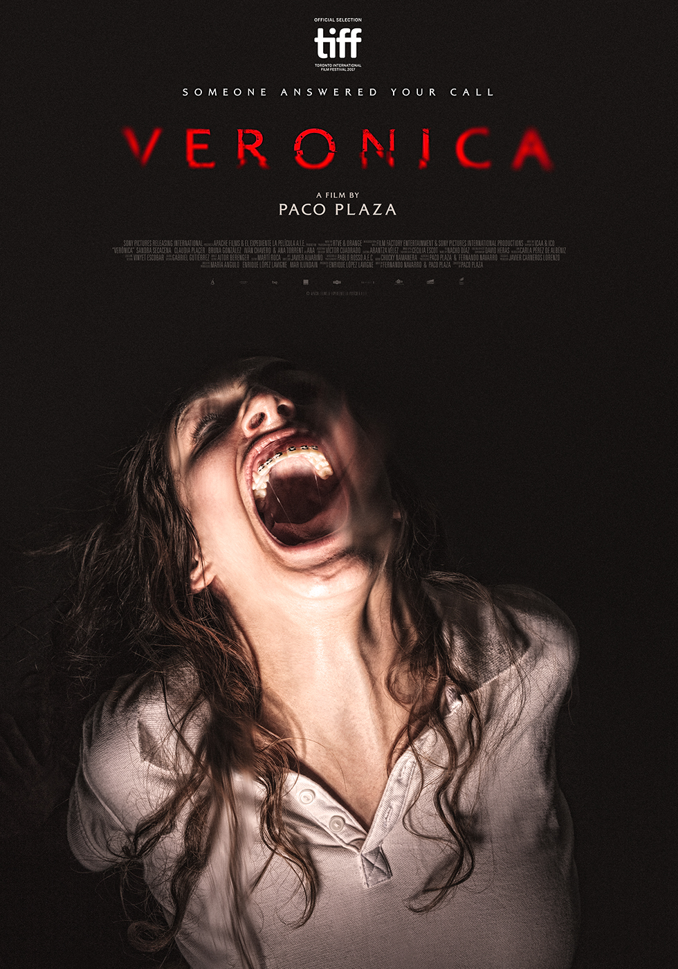Veronica  film poster, featuring a screaming teenage girl, Veronica, on a black background.