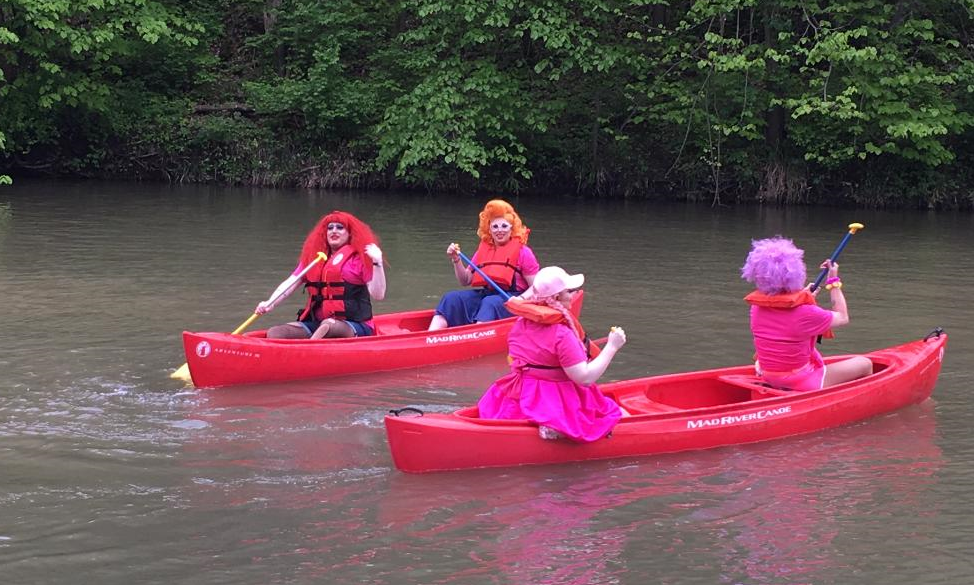 I wasn't exaggerating when I said the contestants are in full drag doing actual summer camp activities like a canoe race.
