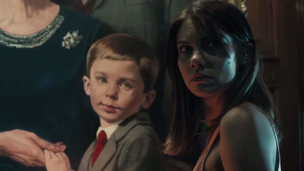 The nanny is the only one to see the evil doll in action in  The Boy . She literally cannot escape his stare even from the painting that hangs on the wall of his living form.