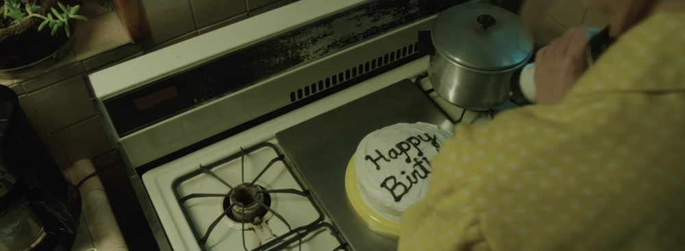 """""""Her Only Living Son,"""" a mother prepares a cake for her son's 18th birthday."""