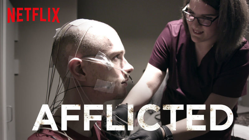 Afflicted  splash screen, featuring the  Afflicted  and  Netflix  logos and a patient being monitored for symptoms.