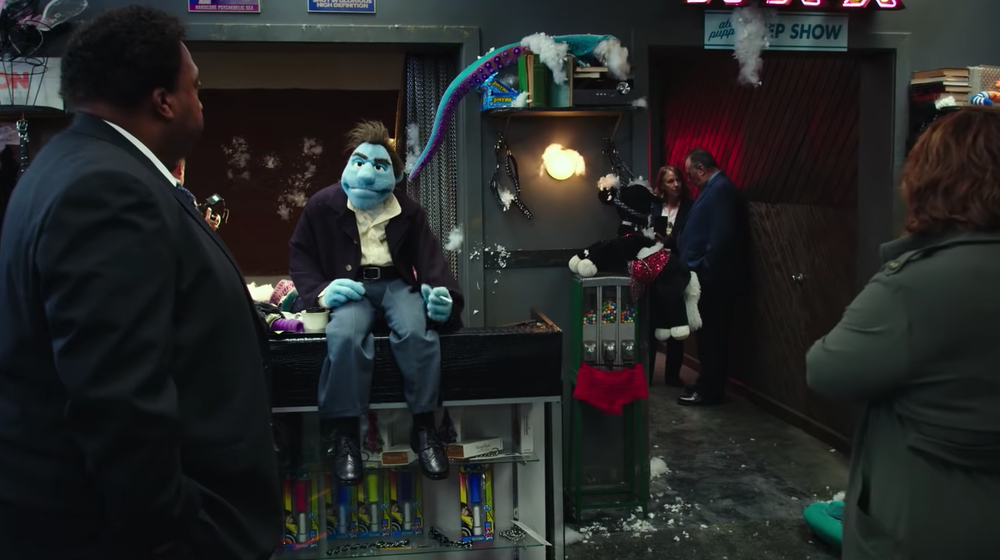 The first murders are funny because they happen in a pornography store run by a puppet. Get it? Get it? No? There's no actual joke there even though it's edited like high camp comedy? Then why is it such a long scene at the start of the film?