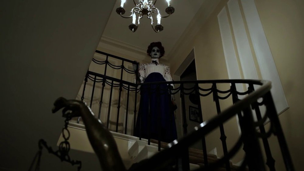 Writer Nicole Holland is an intimidating horror baddie as the ghost of Lizzie Borden.