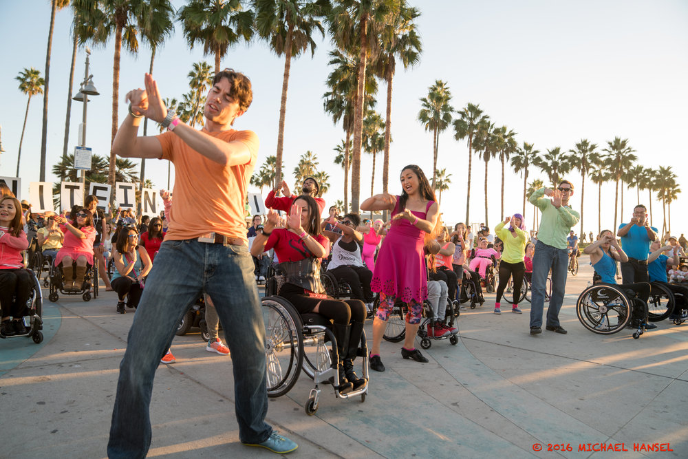 Marisa leads the community in Infinite Flow's 1st flashmob. Photo by Michael Hansel