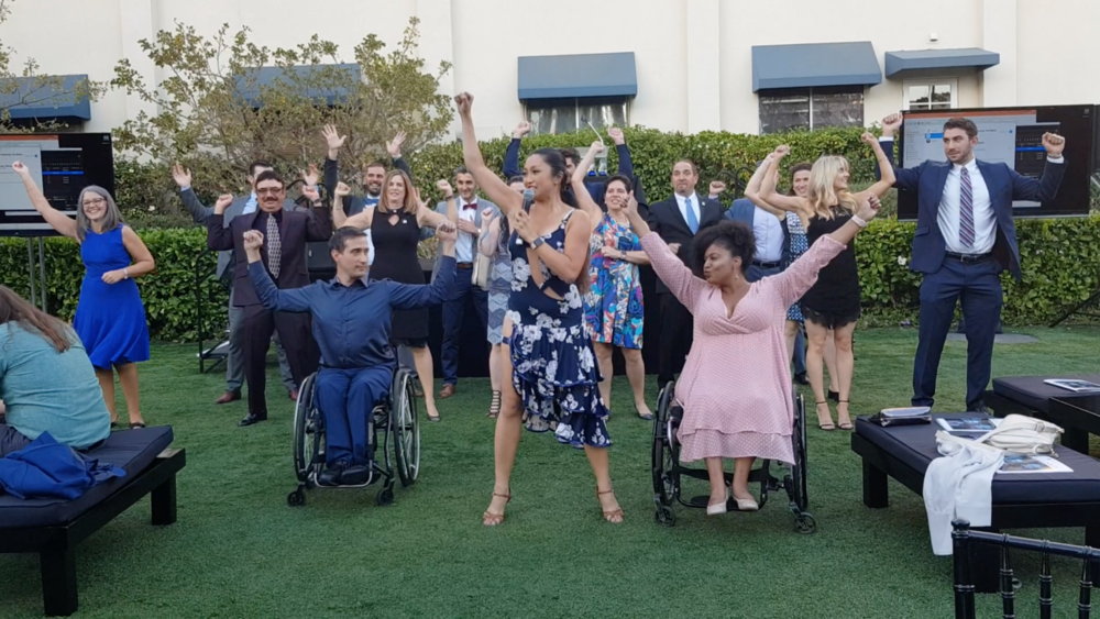 Marisa leads a group of lawyers to dance at the Disability Rights Legal Center Gala
