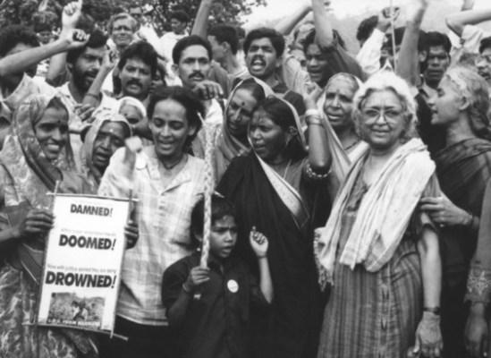 Devaki Jain, far right, at a women's rights rally   Photo credit: devakijain.com .