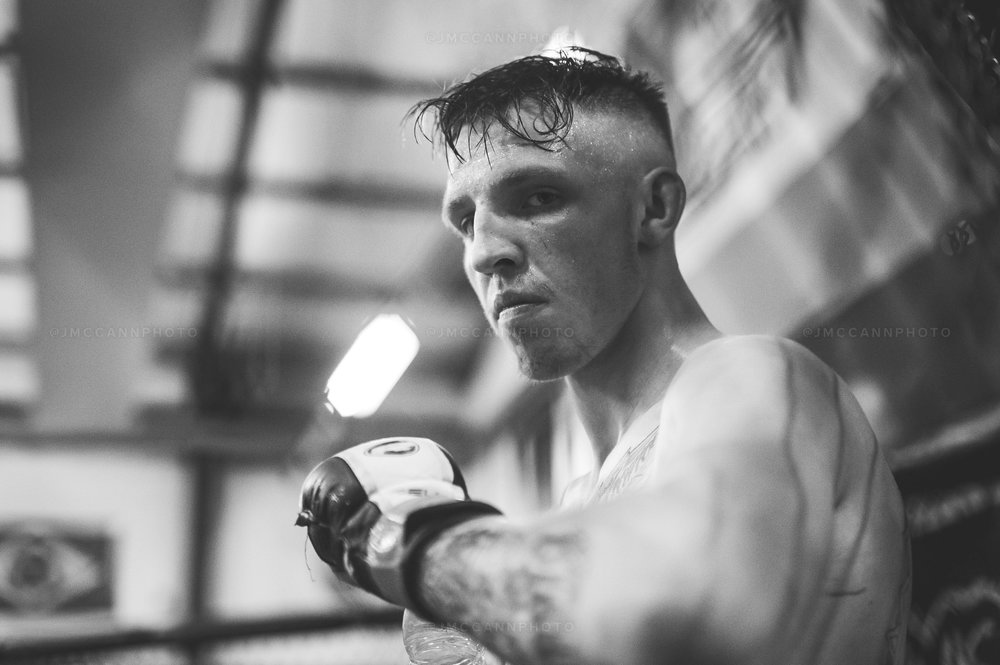 Rhys takes a well deserved break in between rounds at FAI Belfast, during sparring with Joe McColgan and Decky Dalton.