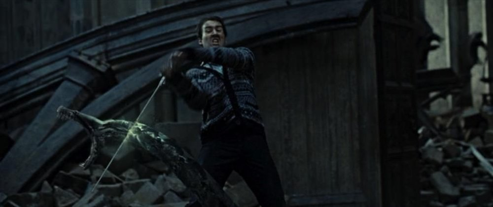Neville Longbottom severs the head of Nagini,  Harry Potter and the Deathly Hallows, pt 2