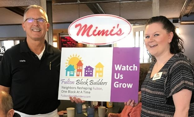 Jennifer Whalen from FBB is seen here with Chris Sachel after receiving a BLOCK BUILDER donation from Mimi's Diner. Patrons of Mimi's will find delicious sandwiches and other American favorites at Mimi's Drive Inn in Fulton. Prices at Mimi's are a bargain, so you'll have plenty of cash left over to treat a friend (or two). Mimi's Drive Inn is a great place to go for lunch or dinner, so make your way over to the restaurant today and munch on an American classic. And let Chris and the gang know how much you appreciate their support of the Fulton Block Builder program!
