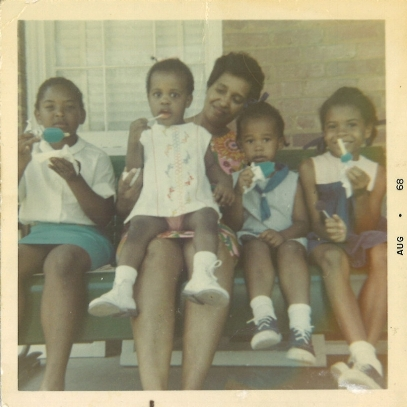 marya annette mcquirter, 2nd from right, enjoys popsicles, with her sisters and cousin, bought by aunt, who still lives in this house on 6th place, ne.  marya was 3 in aug 1968.