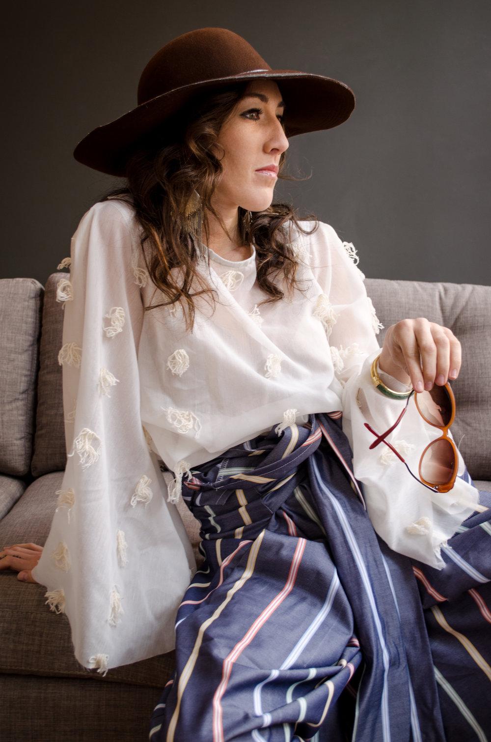 Textured cotton cream white kimono sleeve blouse paired with striped cotton wide leg romper.