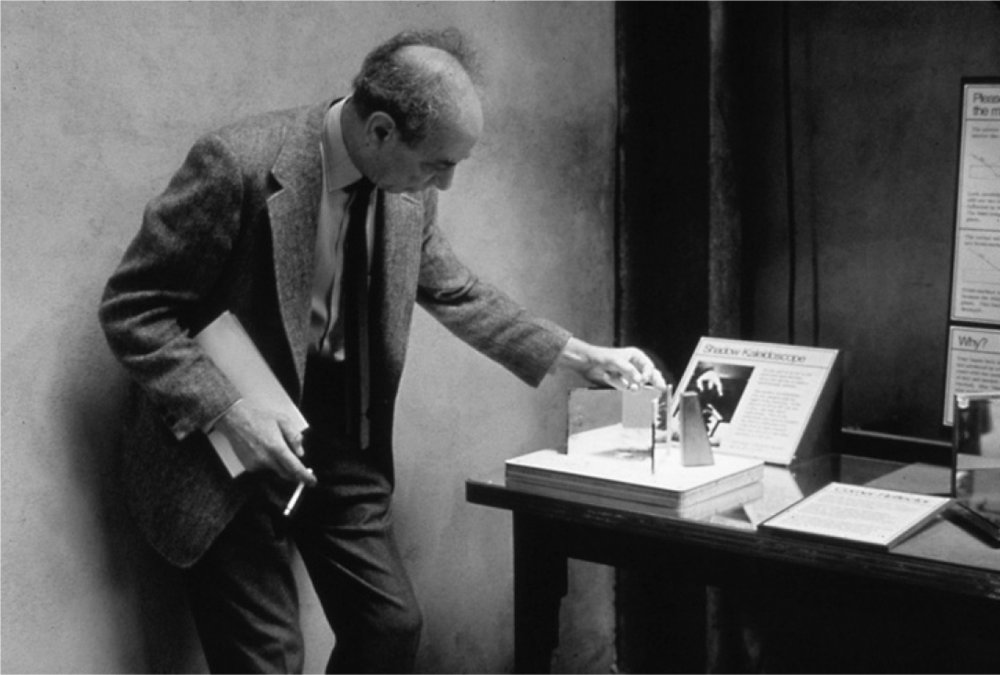 Frank Oppenheimer playing with Shadow Kaleidoscope. And smoking. Ah, the old days . . .