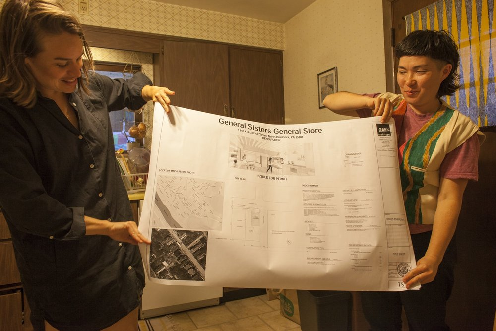 Dana Bishop-Root and Ginger Brooks Takahashi holding up the plan for General Sisters General Store, 10 April 2017. Photo by Colter Harper