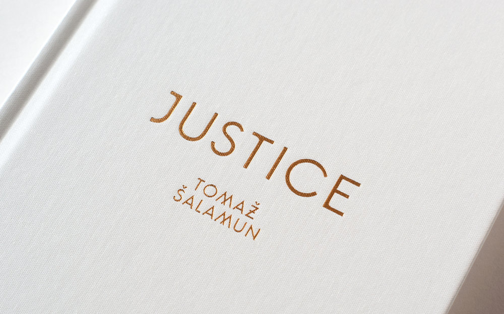 Justice by Tomaz Salamun, published by Black Ocean books. Book cover design by Abby Haddican. Gold foil on white clothbound book. Detail of foil-stamped custom type.