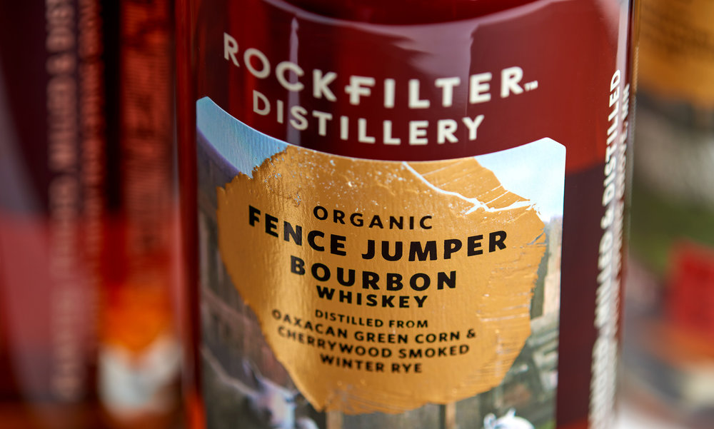 Detail of gold foil stamping on RockFilter Fence Jumper Bourbon whiskey. Designed by Abby Haddican and Sarah Forss at Werner Design Werks.