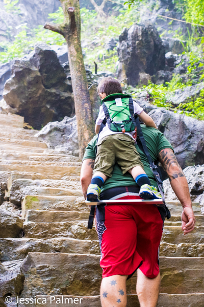Ripley (aged 3.5 years) hitching a ride on the Piggy Back Rider whilst exploring Bich Dong Pagoda, a cluster of Buddhist cave temples built into the side of a cliff, in Ninh Binh, Vietnam.