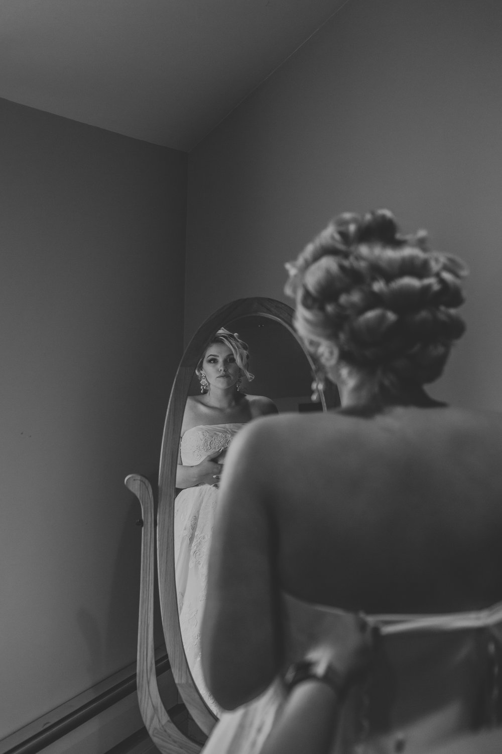 black and white bride looking in mirror