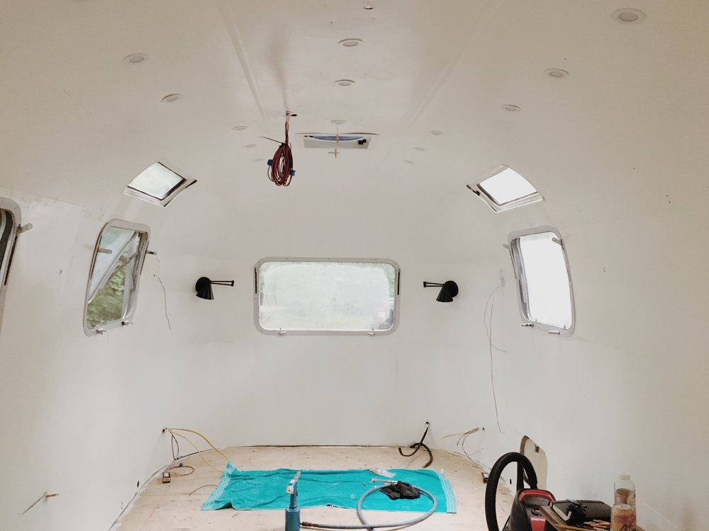 Everything starting to come together. The recessed 12v lights came from Amazon and we love how they look so much we may replace the ones in our own Airstream. Link below - we purchased the white finish, which we love. The lights blend in perfectly with the ceiling, keeping the look clean throughout, which is good, since we have 35 lights up there!    The 12v swing arm sconces are from   Lucent Lightshop  , and were custom made for our partnership. They are launching a 12v line of RV lighting and asked if we'd try out their product. We love how they look and the smaller sizing suits the Airstream bedroom space so well.