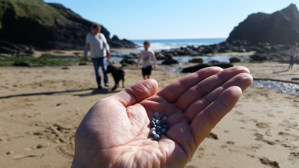 Fist full of nurdles; the bad boys of beach litter.  These tiny balls of plastic are used as raw material in industrial processes.  They are often spilled into the environment and are found in their hundreds of thousands on beaches around the world.