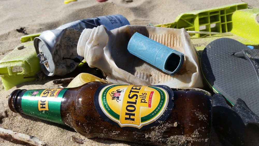 Beer bottle and Asthma inhaler amongst the litter we found.