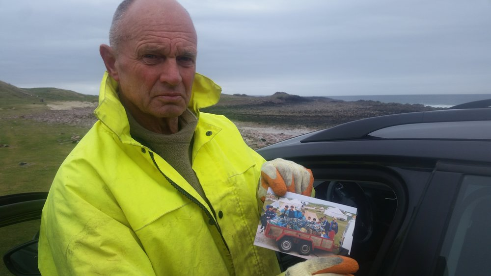 Bill Smith and a picture of him in 1979 with a similar trailer load of litter on a beach clean at Stoer Beach .