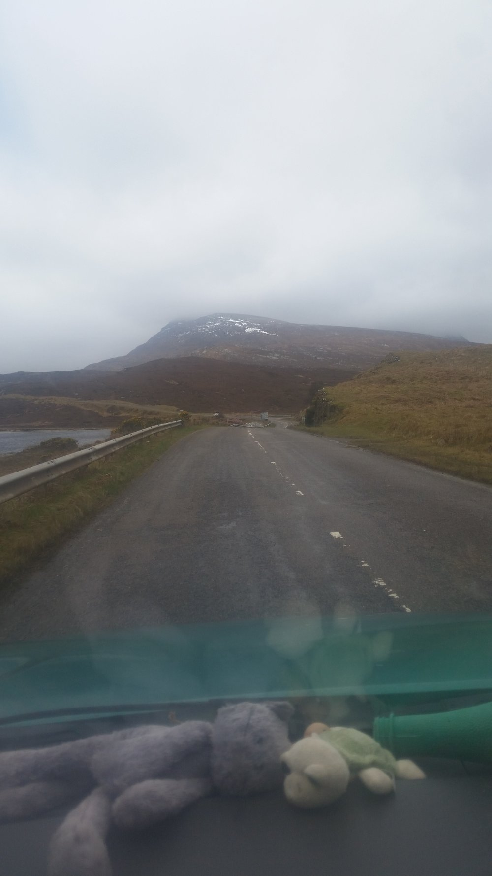 Misty, snow capped mountains of the Highlands.