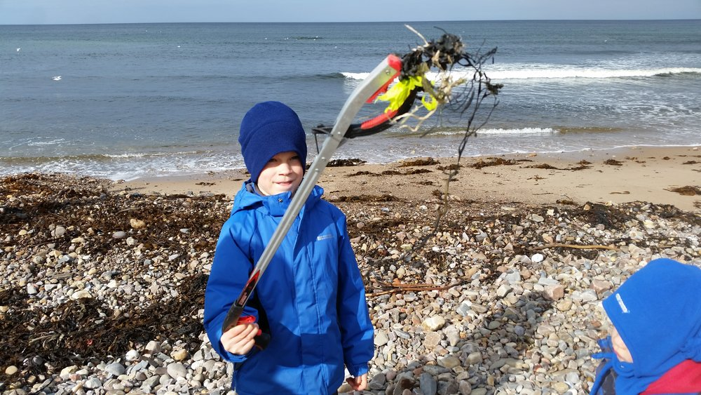 Maxime (8 years old) since asked Mother Julie if he can clean beaches as a job!