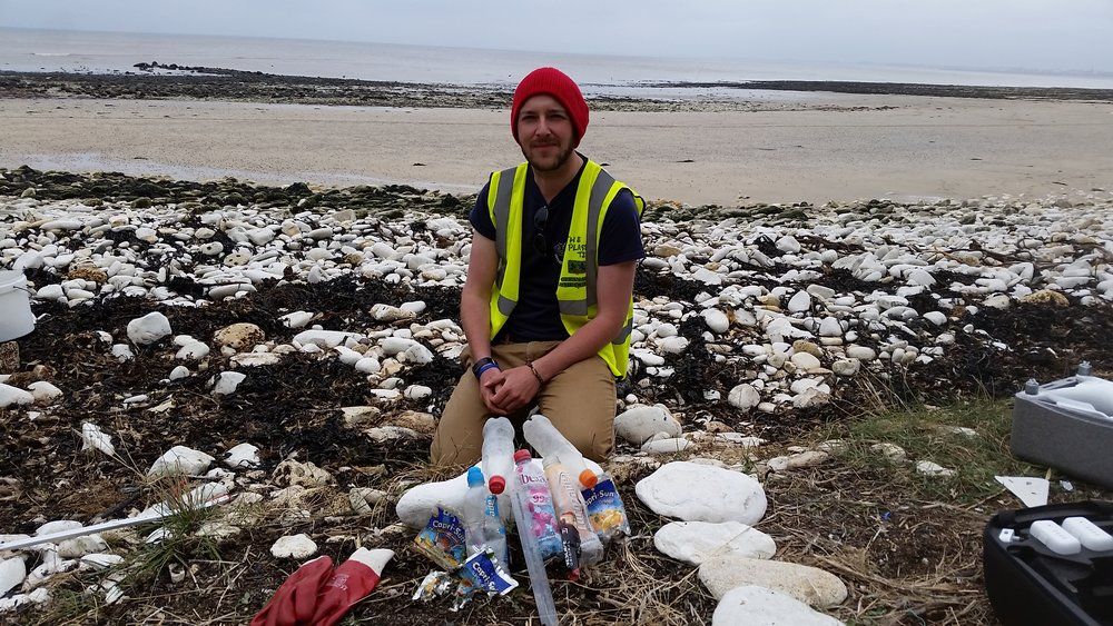 Pete with the branded items we found on South Landing Beach, East Riding.