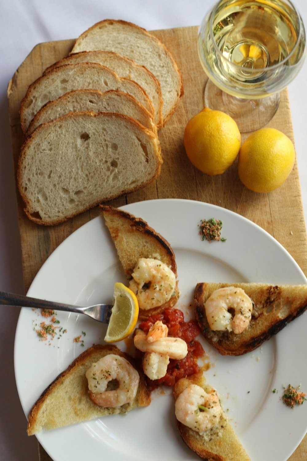 Shrimp de Provence   wild caught shrimp sauteed in herbes de Provence butter, grilled Tuscan bread, Italian salsa