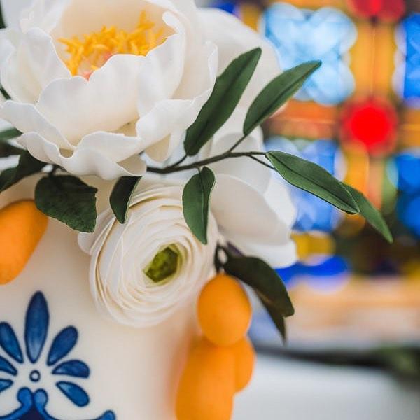 Digging the Mediterranean vibes of this one ❤️ Photo by Shadow and Light Venue @main_street_abbey  Sailor blue edible art paint @sweetsticksau  Fondant and gumpaste @satin.ice  #wedding #weddingcake #stlbaker #stlwedding #sugarflowers #gumpasteflowers #peony #ranunculus #kumquats #sugarart #foodphotography #desserts