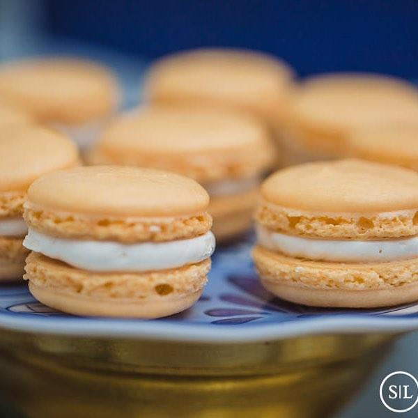 Salted caramel macarons  What is your favorite macaron flavor?  Photo by @shadowandlightstl  Event planner @ssdevents  Venue @main_street_abbey  #macarons #wedding #saltedcaramel #cookies #desserttable #sweets #dessert #foodphotography #stlwedding #cake #sugarart