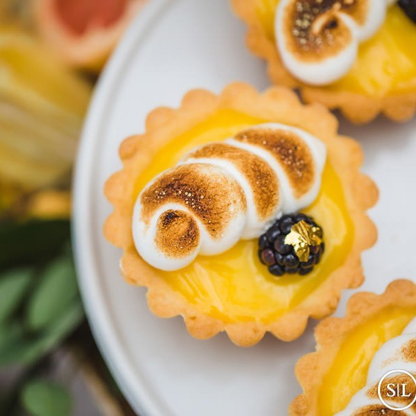 Lemon Meringue and a blackberry tartlets with a touch of gold  We loved the theme of this wedding - shades of blues and citrus, designed by the amazing @ssdevents  Photo by @shadowandlightstl  #foodphotography #lemonmeringue #pie #citrus #sweets #dessert #wedding #stlwedding #foodie #cake #cakedecorating #foodblogger #foodporn