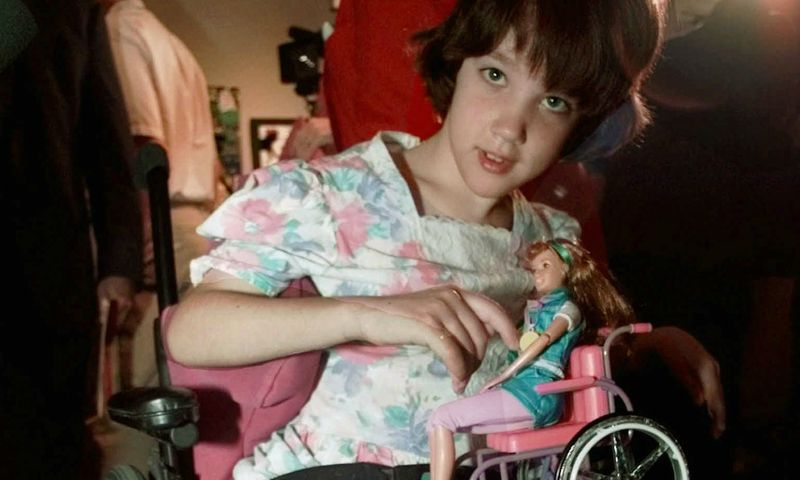 """Hannah Withers, who was 9 at the time, at the unveiling of Mattel's """"Share a Smile Becky"""" doll in 1997 (Susan Walsh / Associated Press)."""