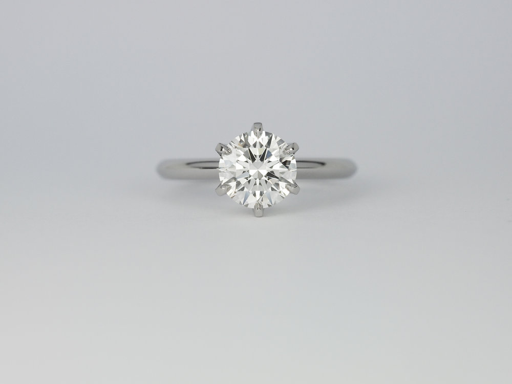 Six claw solitaire platinum engagement ring