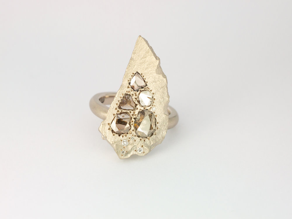 White gold rock engagement ring with rose cut diamonds