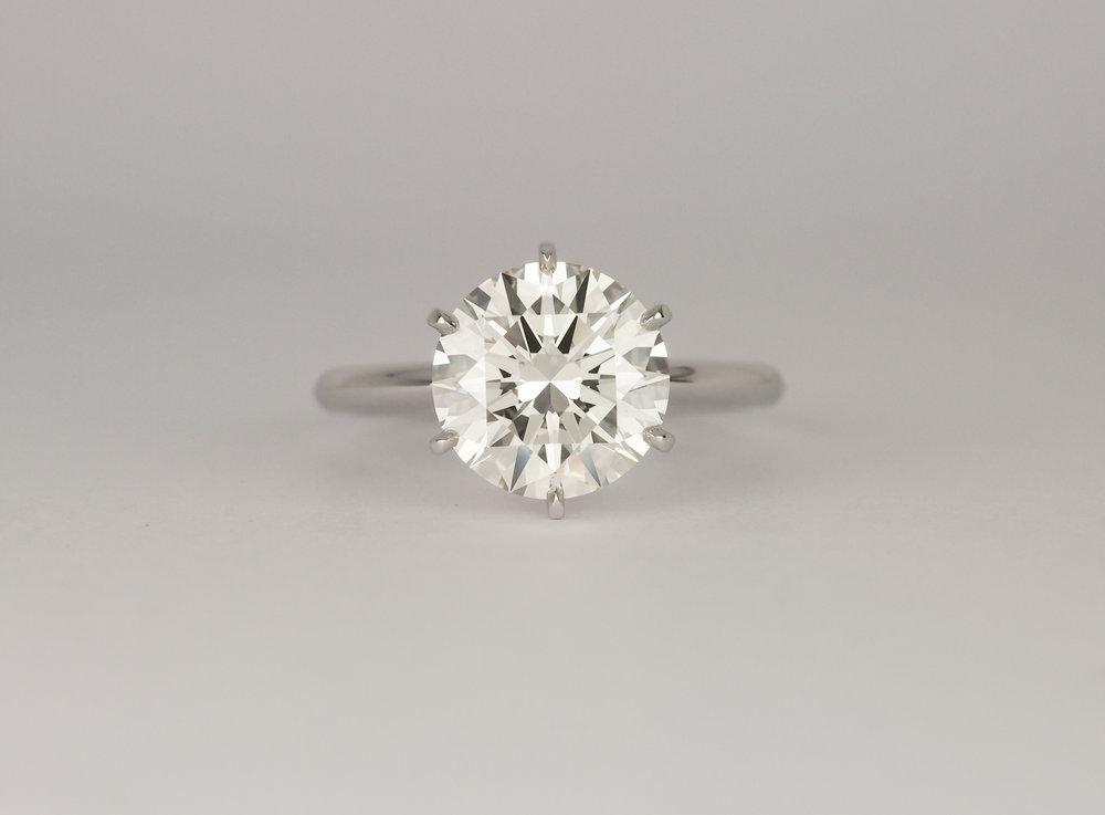 Six claw solitaire round brilliant cut platinum engagement ring