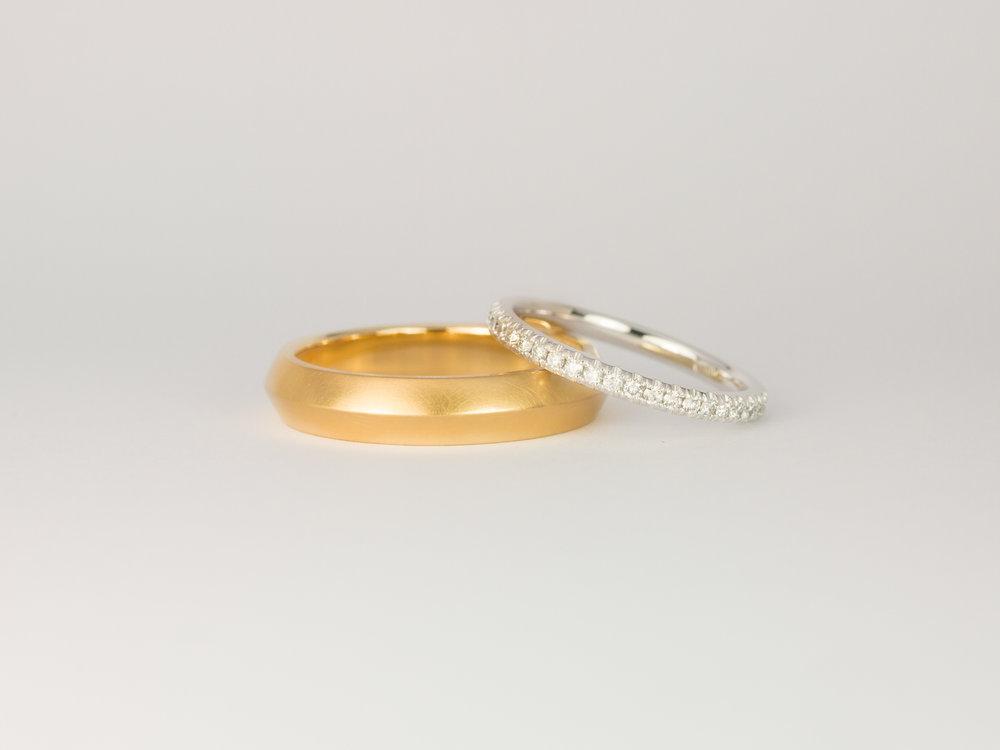 Men's yellow gold and ladies diamond microset wedding band